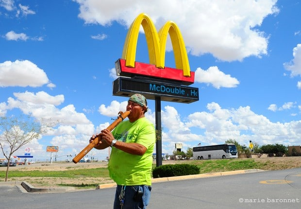 Kayenta Arizona 2013. Jimmy plays its flute for tourists at Macdonald